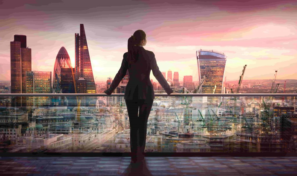 Businesswoman looks over London skyline