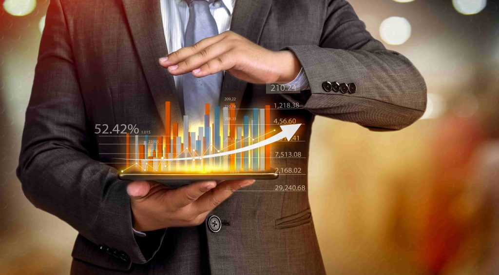 Man holds 3D bar graph of business growth between his hands